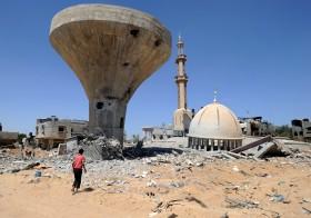 Palestinians searches through rubble