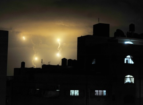 Israeli forces' flares light up the night sky of Gaza City