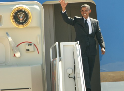 MARINE CORPS AIR STATION MIRAMAR, Calif. - President Barack Obama waves to guests and service members as he exits Air Force One aboard Marine Corps Air Station Miramar Sept. 26.  Obama stopped to thank Marines for their military service and greet guests before leaving for a campaign stop in La Jolla, Calif.