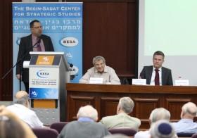 Dr. Shlomo Shpiro speaks at the conference opening aside Prof. Efraim Inbar and Dr. Jürgen Nielsen-Sikora.